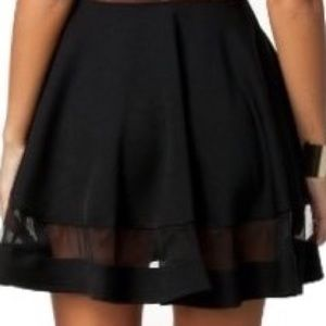 A black chic skirt with a mesh line